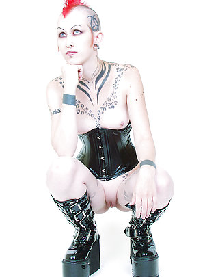 Tattooed corseted Punk rocker with glass sex toy