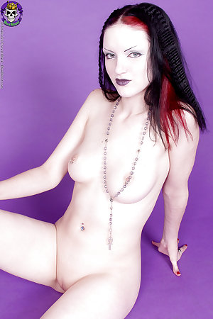 Young shaved Gothic babe with Rosary and nothing else