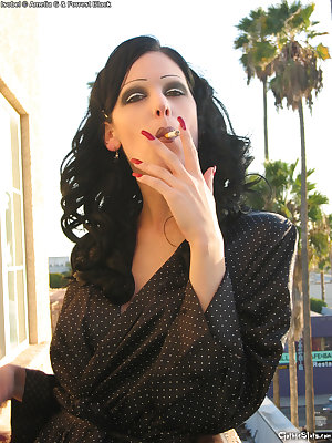 busty goth glam slut smokes on motel balcony