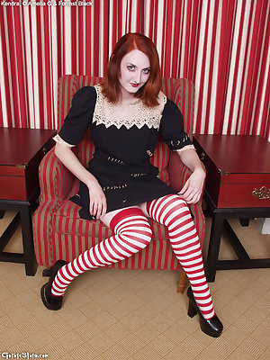 girl plays innocent in lace dress stripe stockings